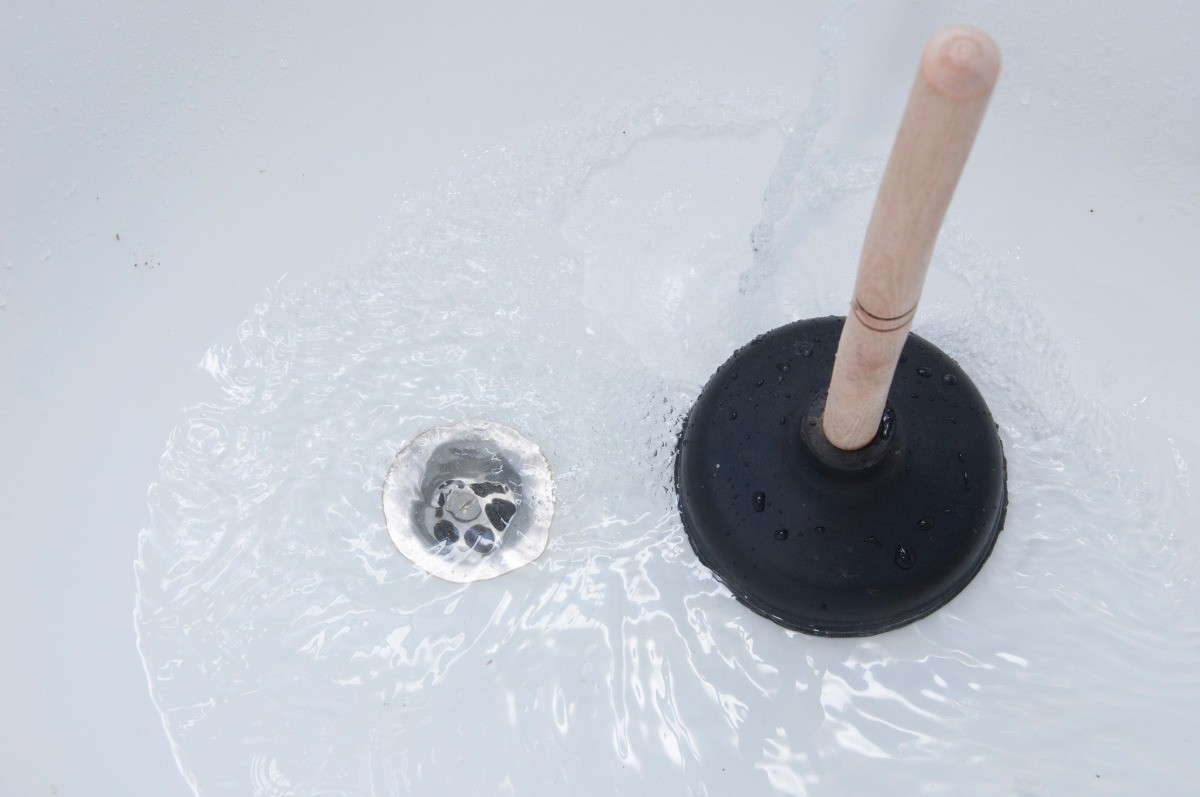 Position your plunger directly over the bathtub drain and start pumping